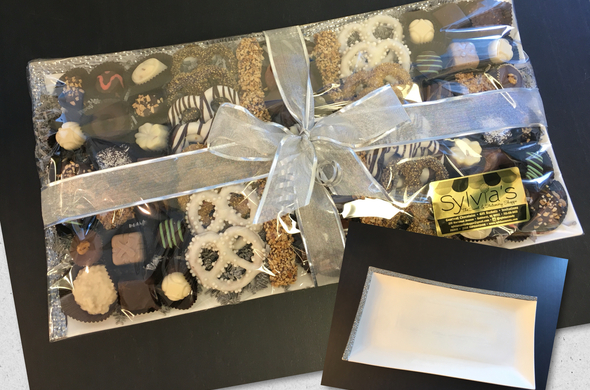 Large  ceramic platter with chocolates and pretzels